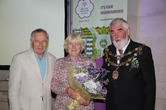 Pat Graham was presented with a bouquet in recognition of her MBE
