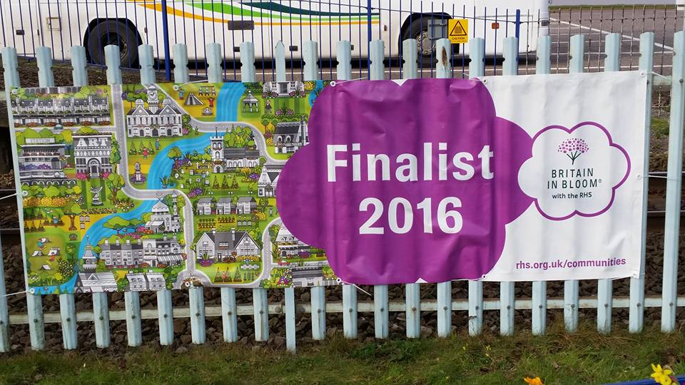 Banner for national finalists displayed on station railings